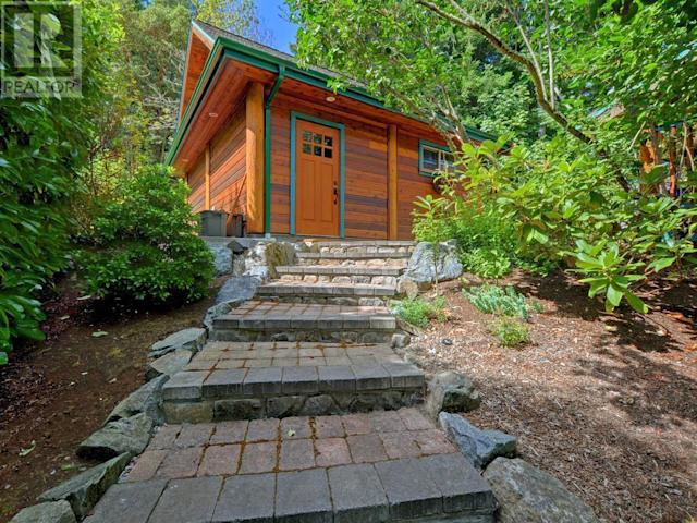 <p><span>8701 Griggs Terrace, North Saanich, B.C.</span><br> The home sits on 0.57 acres, has plenty of natural landscaping, and has a two-car detached garage.<br> (Photo: Zoocasa) </p>