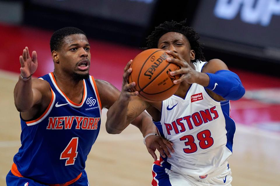 Detroit Pistons guard Saben Lee (38) attempts a layup as New York Knicks guard Dennis Smith Jr. defends during the second half of a preseason NBA basketball game Friday, Dec. 11, 2020, in Detroit.