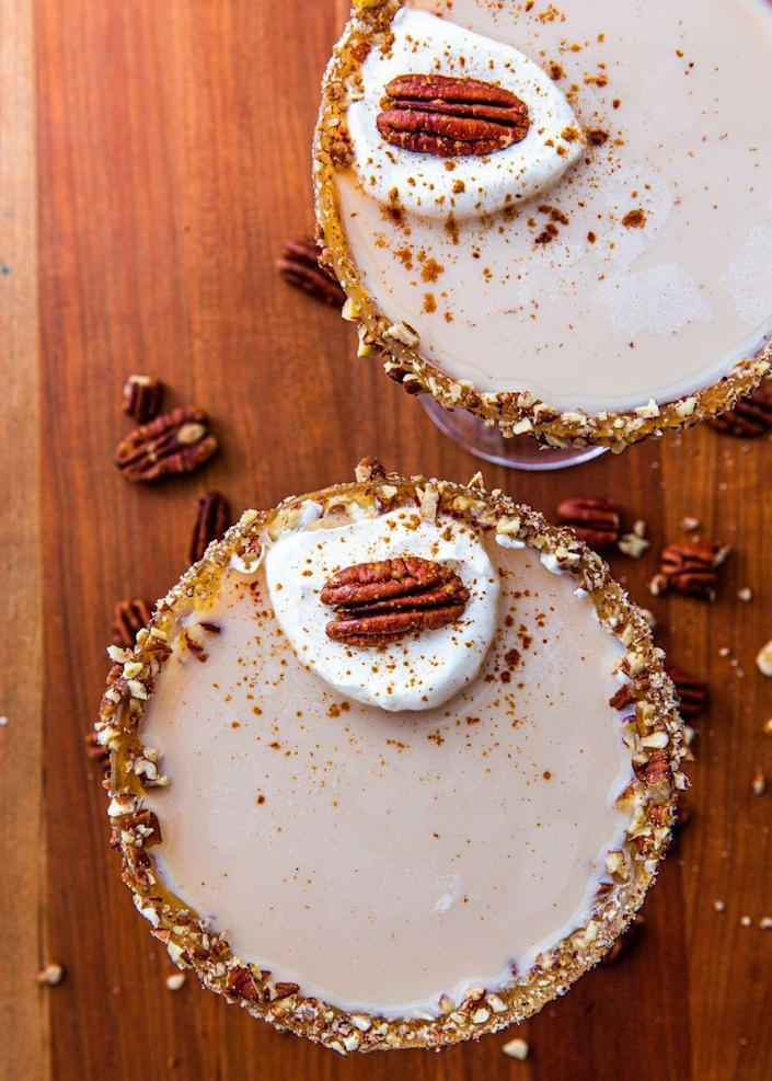 """<p>These martini's might <em>look</em> innocent, but trust us, they're STRONG.</p><p>Get the recipe from <a href=""""https://www.delish.com/cooking/recipe-ideas/a24132507/pecan-pie-martini-recipe/"""" rel=""""nofollow noopener"""" target=""""_blank"""" data-ylk=""""slk:Delish"""" class=""""link rapid-noclick-resp"""">Delish</a>.</p>"""