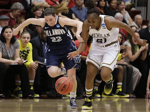 Villanova's Devon Kane, left, and Michigan's Nya Jordan (21) chase a loose ball during the first half of a first-round game in the women's NCAA college basketball tournament on Sunday, March 24, 2013, in Stanford, Calif. (AP Photo/Ben Margot)