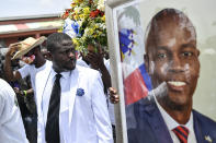 """Jimmy Cherizier, alias Barbecue, a former police officer who heads a gang coalition known as """"G9 Family and Allies,"""" leads a march to demand justice for slain Haitian President Jovenel Moise in La Saline neighborhood of Port-au-Prince, Haiti, Monday, July 26, 2021. Moise was assassinated on July 7 at his home. (AP Photo/Matias Delacroix)"""