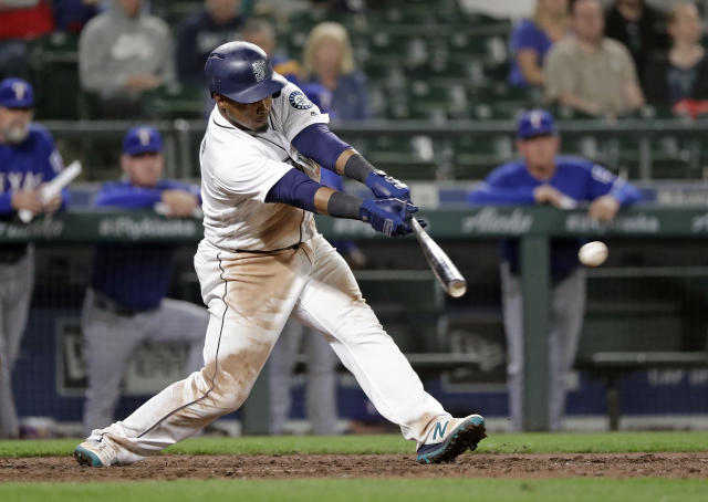 Seattle Mariners' Jean Segura singles in a run against the Texas Rangers in the eighth inning of a baseball game Tuesday, May 15, 2018, in Seattle. (AP Photo/Elaine Thompson)