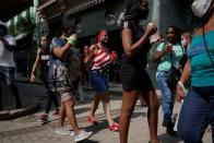 A woman wears a T-shirt with colors of the U.S. flag in downtown Havana