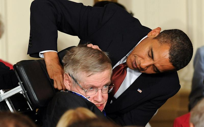 Stephen Hawking receives the Presidential Medal of Freedom from US President Barack Obama - AFP