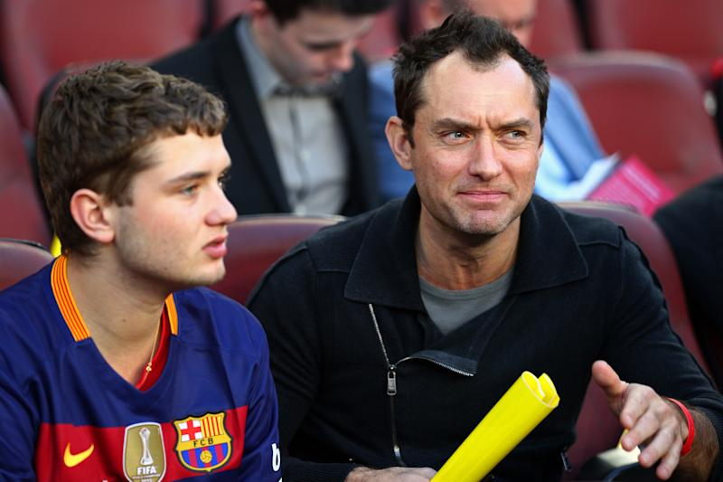 Jude Law and son Rafferty Law take their seat before the start of the La Liga match between FC Barcelona and Real Madrid CF at Camp Nou on April 2, 2016 in Barcelona, Spain. (Photo by Paul Gilham/Getty Images)