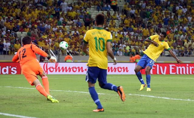 FORTALEZA, BRAZIL - JUNE 19: Jo of Brazil scores his team's second goal during the FIFA Confederations Cup Brazil 2013 Group A match between Brazil and Mexico at Castelao on June 19, 2013 in Fortaleza, Brazil. (Photo by Scott Heavey/Getty Images)