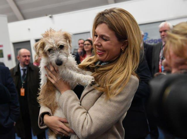 Carrie Symonds with her pet dog, Dilyn