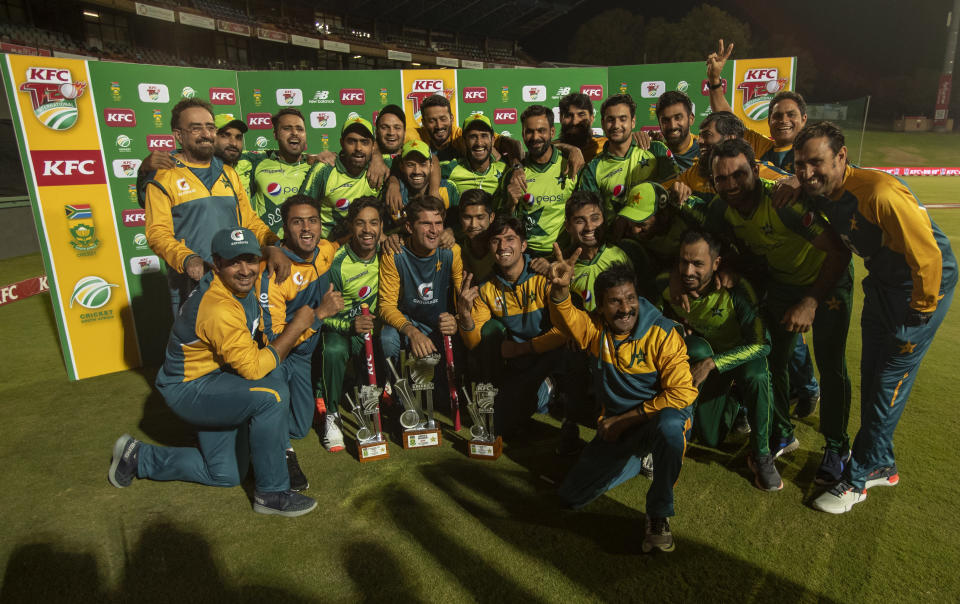 Pakistan players celebrate after winning the fourth and final T20 cricket match between South Africa and Pakistan at Centurion Park in Pretoria, South Africa, Friday, April 16, 2021. Pakistan beat South Africa by 3 wickets to win the series 3-1. (with 1 ball remaining)(AP Photo/Themba Hadebe)