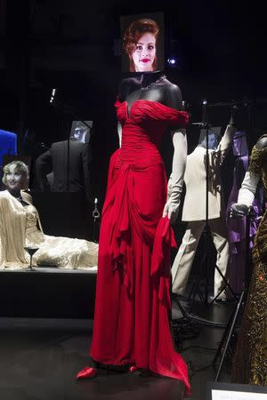 """A costume worn by actress Julia Roberts in the film """"Pretty Woman"""" is shown on display at the Hollywood Costume exhibit, curated by the Academy of Motion Pictures Arts and Sciences and London's Victoria & Albert museum, at the future home of the Academy Museum of Motion Pictures in Los Angeles, in this publicity photo released to Reuters on September 30, 2014. REUTERS/Greg Harbaugh/Copyright 2014 AMPAS/Handout via Reuters"""