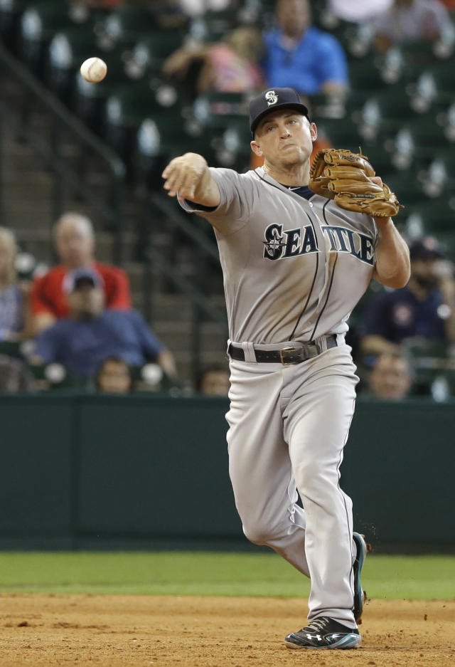 Seattle Mariners third baseman Kyle Seager throws to first base for the out on Houston Astros' Kike Hernandez in the eighth inning of a baseball game onWednesday, July 2, 2014, in Houston. (AP Photo/Pat Sullivan)