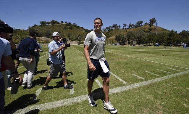 "<a class=""link rapid-noclick-resp"" href=""/nfl/players/6763/"" data-ylk=""slk:Philip Rivers"">Philip Rivers</a> walks off the field after Thursday's minicamp practice, the last in San Diego before the team moves. (AP)"