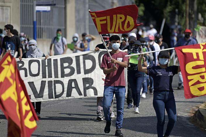 Students from the University of El Salvador rally against Salvadoran President Nayib Bukele in February, a year after a military incursion into the Legislative Assembly in San Salvador.
