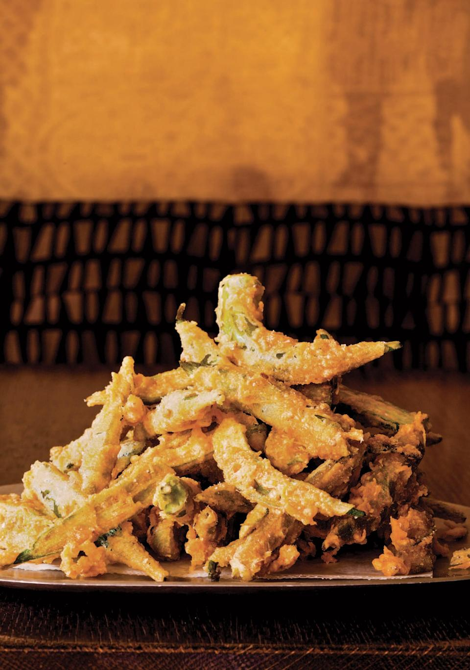 "These remarkably crispy okra fries from <a href=""https://bookshop.org/books/between-harlem-and-heaven-afro-asian-american-cooking-for-big-nights-weeknights-and-every-day/9781250108715"" rel=""nofollow noopener"" target=""_blank"" data-ylk=""slk:Between Harlem and Heaven"" class=""link rapid-noclick-resp""><em>Between Harlem and Heaven</em></a> start with a long soak in egg and a light coating of rice flour, cornstarch, and smoked paprika before they hit the hot oil. <a href=""https://www.epicurious.com/recipes/food/views/okra-fries?mbid=synd_yahoo_rss"" rel=""nofollow noopener"" target=""_blank"" data-ylk=""slk:See recipe."" class=""link rapid-noclick-resp"">See recipe.</a>"