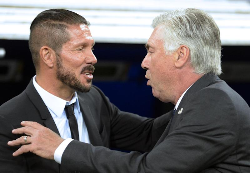 Real Madrid's coach Carlo Ancelotti (R) greets Atletico Madrid's coach Diego Simeone before their Spanish Supercup first-leg match, at the Santiago Bernabeu stadium in Madrid , on August 19, 2014