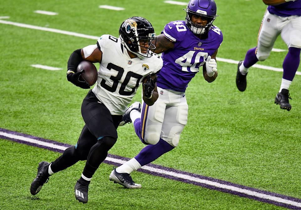 MINNEAPOLIS, MN - DECEMBER 06: Jacksonville Jaguars Running Back James Robinson (30) runs with the ball as Minnesota Vikings Linebacker Todd Davis (40) gives chase during the 2nd quarter of a National Football League game between the Minnesota Vikings and Jacksonville Jaguars on December 6, 2020, at US Bank Stadium, Minneapolis, MN.(Photo by Nick Wosika/Icon Sportswire via Getty Images)