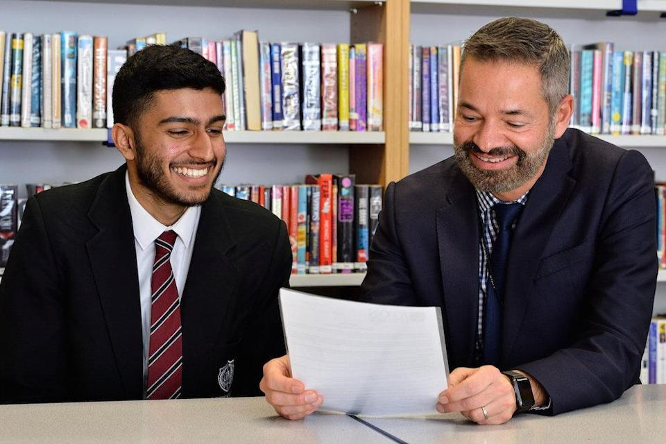 Hasan Patel with George Mitchell headteacher Saeed Hussain (Picture: SWNS)