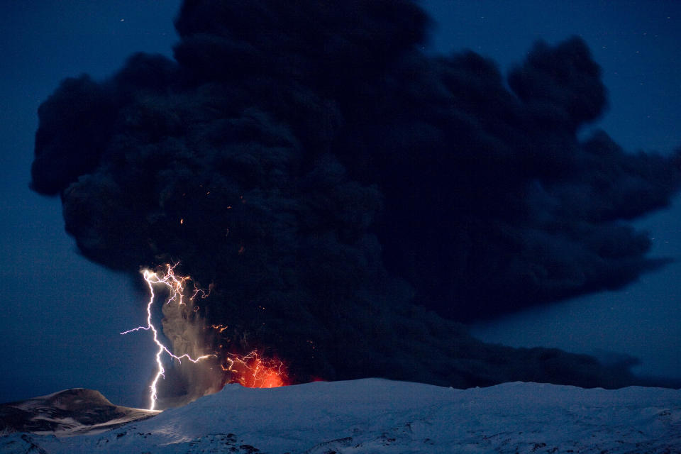 Lighting seen amid the lava and ash erupting from the vent of the Eyjafjallajokull volcano in central Iceland early morning Sunday April 18 2010 as it continues to vent into the skies over Europe. Low-energy lightning is sometimes active during eruptions, arcing between particles as they exit the volcanic vent at around 100 metres per second. The dramatic volcanic eruption which has closed Europe's airspace for days has entered a new phase - producing less smoke but bubbling with lava and throwing up chunks of molten rock. (AP Photo/ Jon Pall Vilhelmsson)