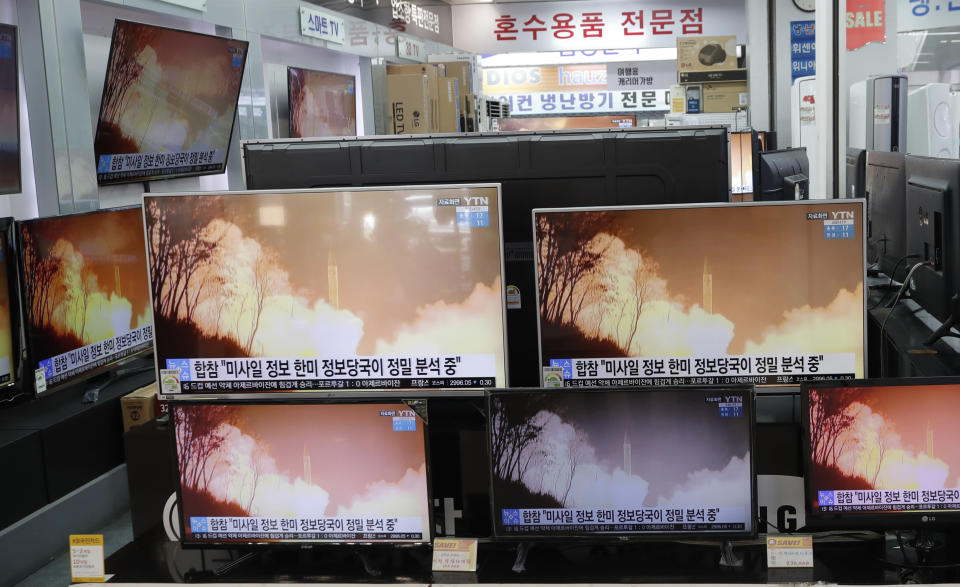 "TV screens showi a news program reporting about North Korea's missiles with file footage at an electronic shop in Seoul, South Korea, Thursday, March 25, 2021. North Korea on Thursday test-fired its first ballistic missiles since U.S. President Joe Biden took office, as it expands its military capabilities and increases pressure on Washington while nuclear negotiations remain stalled. The Korean characters read: ""Joint Chiefs of Staff, South Korea and U.S. intelligence authorities, analyzing the missiles in detail."" (AP Photo/Lee Jin-man)"