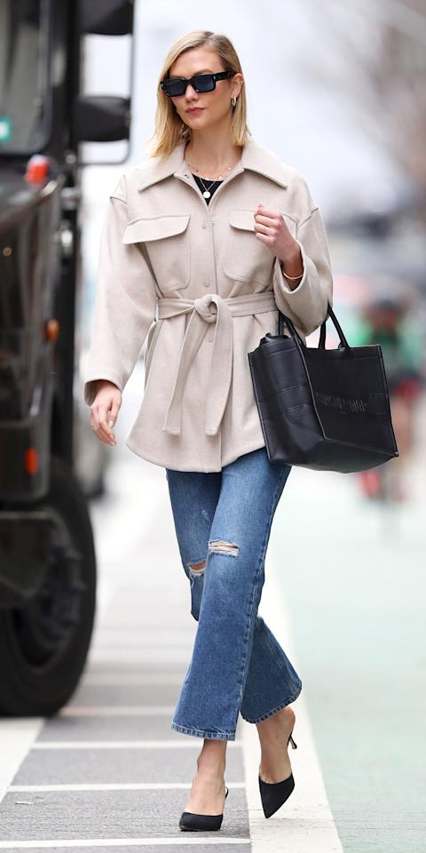 """<p>Karlie Kloss put another nail in the micro-bag trend's coffin by wearing an oversized vintage Dior Book Tote (<strong>Shop similar: </strong>$695; <a href=""""https://click.linksynergy.com/deeplink?id=93xLBvPhAeE&mid=1237&murl=https%3A%2F%2Fshop.nordstrom.com%2Fs%2Fmansur-gavriel-oversize-lambskin-leather-tote%2F5137446%2Ffull%3F&u1=IS%2CKarlieKloss%2Canesta%2C%2CIMA%2C3530153%2C202003%2CI"""" target=""""_blank"""">nordstrom.com</a>). And while bigger bags are definitely more unwieldy, Kloss kept the look sleek in a short trench coat (<strong>Shop similar:</strong> $98; <a href=""""https://click.linksynergy.com/deeplink?id=93xLBvPhAeE&mid=1237&murl=https%3A%2F%2Fshop.nordstrom.com%2Fs%2Fbernardo-hooded-trench-coat%2F5567184%2Ffull%3F&u1=IS%2CKarlieKloss%2Canesta%2C%2CIMA%2C3530153%2C202003%2CI"""" target=""""_blank"""">nordstrom.com</a>) and black kitten heels (<strong>Shop similar: </strong>$80; <a href=""""https://click.linksynergy.com/deeplink?id=93xLBvPhAeE&mid=1237&murl=https%3A%2F%2Fshop.nordstrom.com%2Fs%2Fbella-vita-scarlette-slingback-pump-women%2F4962360%2Ffull%3F&u1=IS%2CKarlieKloss%2Canesta%2C%2CIMA%2C3530153%2C202003%2CI"""" target=""""_blank"""">nordstrom.com</a>). </p>"""