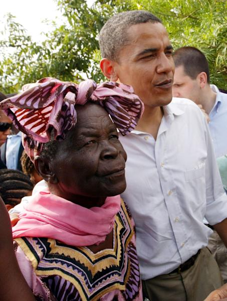 FILE - In this Saturday, Aug. 26, 2006 file photo, the then U.S. Senator Barack Obama, right, walks with his step-grandmother Sarah Obama at his father's house in the village of Kogelo, western Kenya. President Barack Obama promised to visit his father's homeland of Kenya before the end of his presidency but of the 51 country visits Obama made in the last four years, America's first black president spent less than a day in sub-Saharan Africa. Obama is likely to spend more time in Africa in his second term, a presidential historian said. Freed of domestic campaign politics, second-term presidents can travel more in a continent that has less strategic importance than Europe and Asia. (AP Photo/Sayyid Azim, File)