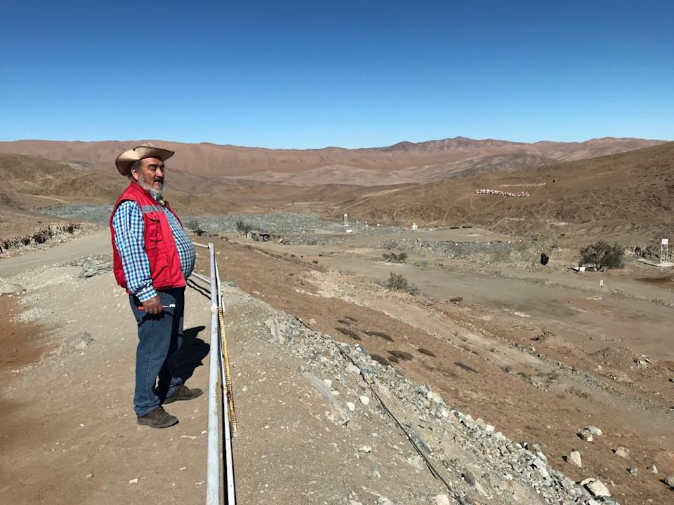 Jorge Galleguillos, one of the 33 Chilean miners who were trapped for 69 days underground in a copper and gold mine, stands in front of the landscape of the San Jose mine, in Copiapo, Chile July 5, 2018. REUTERS/Jorge Vega