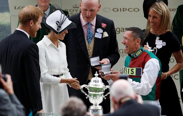 Horse Racing - Royal Ascot - Ascot Racecourse, Ascot, Britain - June 19, 2018 Frankie Dettori celebrates after winning the 4.20 St James's Palace Stakes as Britain's Prince Harry and Meghan, the Duchess of Sussex look on REUTERS/Peter Nicholls
