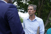 Beto O'Rourke, right, listens to a volunteer before a Texas Organizing Project neighborhood walk in West Dallas Wednesday, June 9, 2021. The former congressman and senatorial candidate is driving an effort to gather voter support to stop Texas' SB7 voting legislation. As politicians from Austin to Washington battle over how to run elections, many voters are disconnected from the fight. While both sides have a passionate base of voters intensely dialed in on the issue, a disengaged middle is baffled at the attention. (AP Photo/LM Otero)
