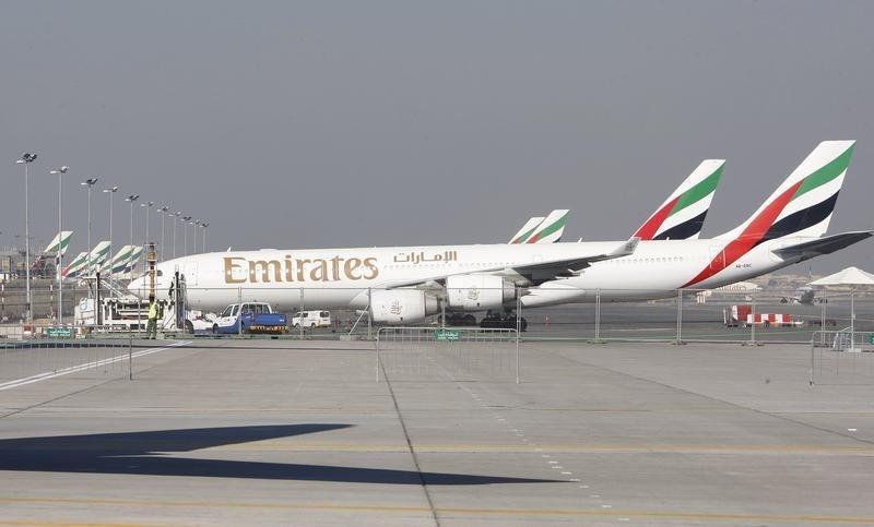 Emirates Airlines planes are parked at the Dubai International Airport during the second day of the Dubai Airshow