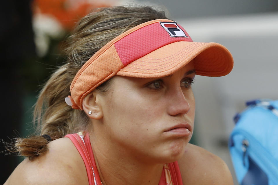 Sofia Kenin of the U.S. reacts to losing the final of the French Open tennis tournament against Poland's Iga Swiatek at the Roland Garros stadium in Paris, France, Saturday, Oct. 10, 2020. (AP Photo/Michel Euler)