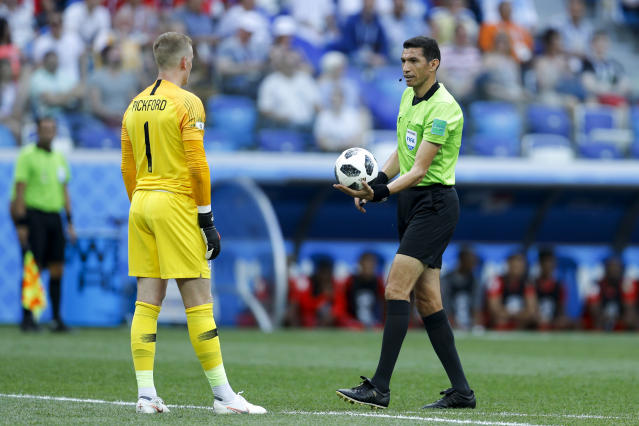 <p>Referee Ghead Grisha from Egypt hurries England goalkeeper Jordan Pickford during the group G match </p>