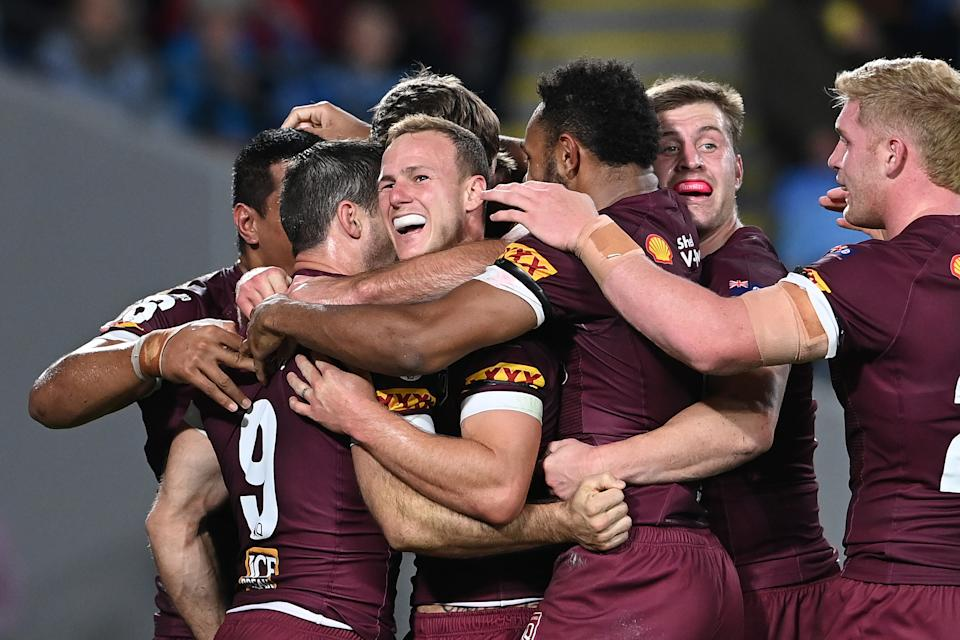 Ben Hunt celebrates with team mates after scoring his second try during game three of the 2021 State of Origin Series between the New South Wales Blues and the Queensland Maroons.