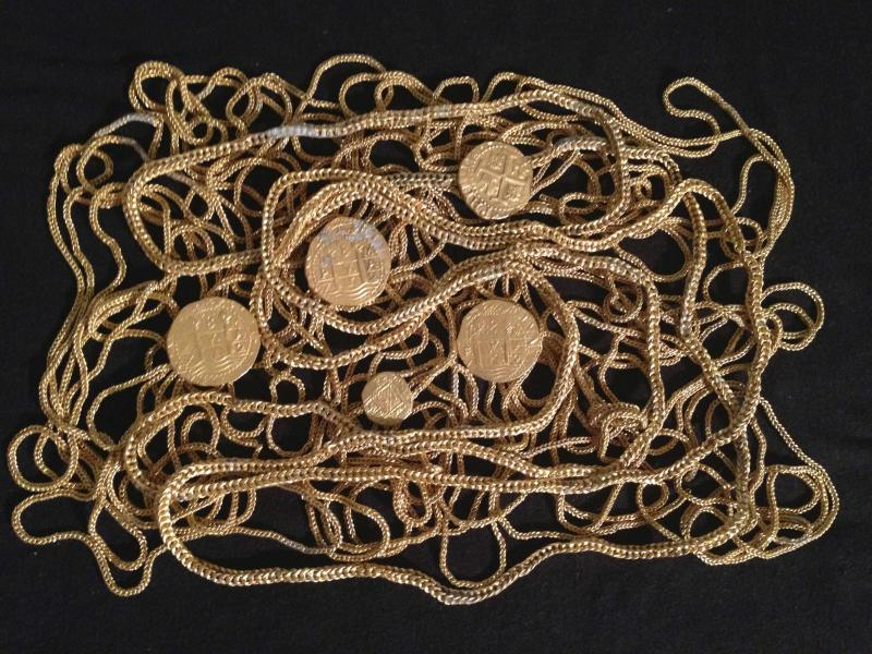 A Schmitt family photo shows gold chains and coins from a wreckage of a convoy of 11 ships that went down in a hurricane off the coast of Florida