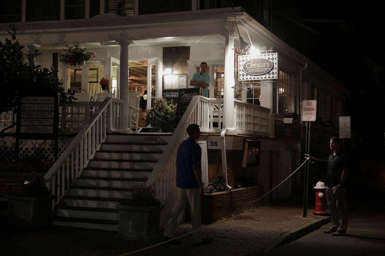 Secret Service agents stand outside Chesca's restaurant as U.S. President Barack Obama and U.S. First Lady Michelle Obama have dinner in Edgartown, Massachusetts, U.S., August 20, 2016. REUTERS/Joshua Roberts