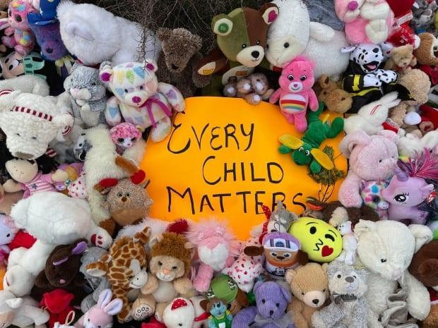 People heaped teddy bears and other childhood toys outside Happy Valley-Goose Bay's town hall Monday afternoon.