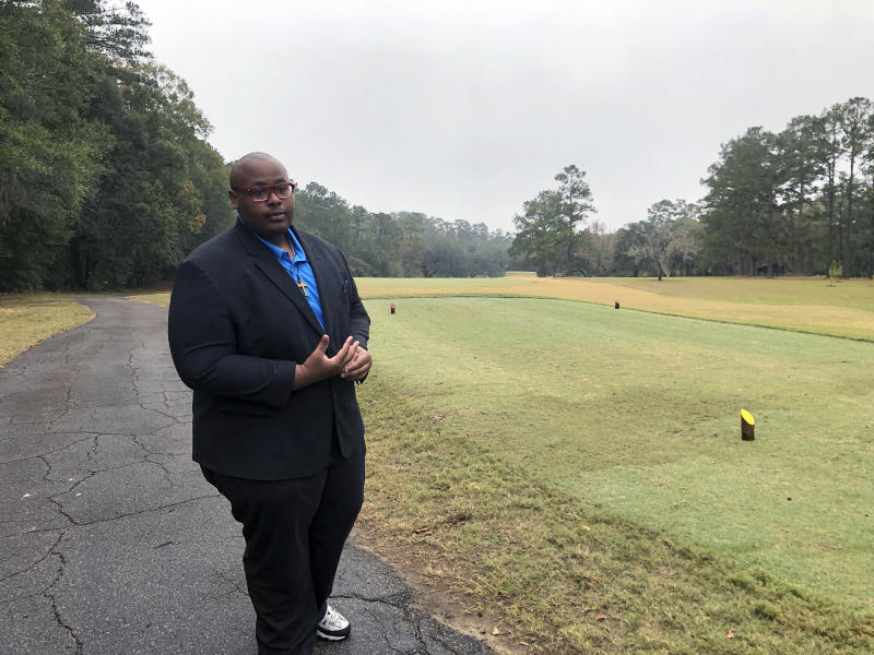 Delaitre Hollinger, the immediate past president of the Tallahassee branch of the NAACP,  visits the Capital City Country Club in Tallahassee, Fla., on Dec. 17, 2019. The discovery this month of 40 graves _ with perhaps dozens more yet to be found _ has spawned discussion about how to dignify the souls who lay in eternal rest at the golf course.    Hollinger says the slaves buried at the country club deserve to have their dignity restored.   (AP Photo/Bobby Caina Calvan)