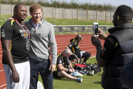 Britain's Prince Harry Patron of the Invictus Games Foundation, poses with a competitor as he attends the UK team trials for the Invictus Games Toronto 2017 held at the University of Bath, Britain April 7, 2017. REUTERS/Chris Jackson/Pool