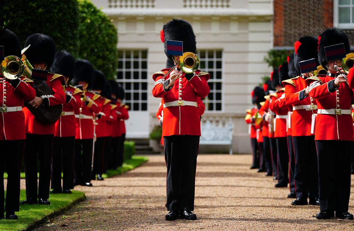 LONDON, ENGLAND - JULY 6: The Band of the Coldstream Guards play 'Three Lions' and 'Sweet Caroline' in the gardens of Clarence House ahead of England's Euro 2020 semi-final game against Denmark on July 6, 2021 in in London, England. In support to the England Football Team as they approach their Semi-Final match in the UEFA Euro Championships on Wednesday evening The Prince of Wales and The Duchess of Cornwall invited the Band of the Coldstream Guards into the Clarence House Garden to play the following pieces: Three Lions – Composed by Ian Broudie, arranged by Oliver Jeans and Sweet Caroline – Composed by Neil Diamond, arranged by Tim Waters.  (Photo by Victoria Jones-WPA Pool/Getty Images)