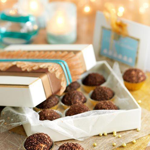"""<p>These sweet treats make a great home-made Christmas gift.</p><p><strong>Recipe: <a href=""""https://www.goodhousekeeping.com/uk/food/recipes/peanut-butter-balls?click=main_sr"""" rel=""""nofollow noopener"""" target=""""_blank"""" data-ylk=""""slk:Peanut butter balls"""" class=""""link rapid-noclick-resp"""">Peanut butter balls</a> </strong><br><br><br><br></p>"""