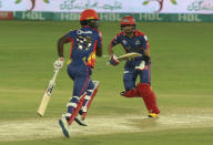 Karachi Kings Babar Azam, right, and Chadwick Walton run between the wickets during the final of their Pakistan Super League T20 cricket match against Lahore Qalandars at National Stadium in Karachi, Pakistan, Tuesday, Nov. 17, 2020. (AP Photo/Fareed Khan)