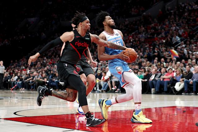 PORTLAND, OR - APRIL 10: Marvin Bagley III #35 of the Sacramento Kings dribbles against Gary Trent Jr. #9 of the Portland Trail Blazers in the fourth quarter during their game at Moda Center on April 10, 2019 in Portland, Oregon. (Photo by Abbie Parr/Getty Images)