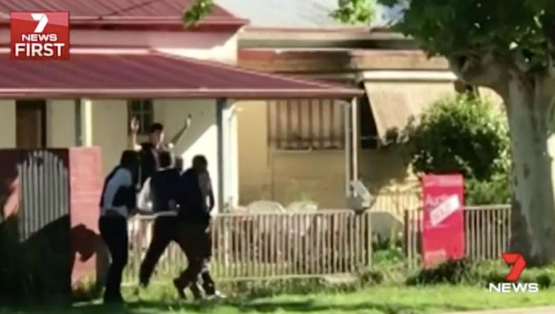 Anthony Hagan surrenders to heavily armed detectives. Source: 7 News