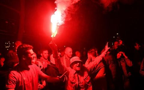 Fans light flares outside the stadium prior to the 2020 UEFA European Championships Group A qualifying match between Montenegro and England at Podgorica City Stadium - Credit: Getty