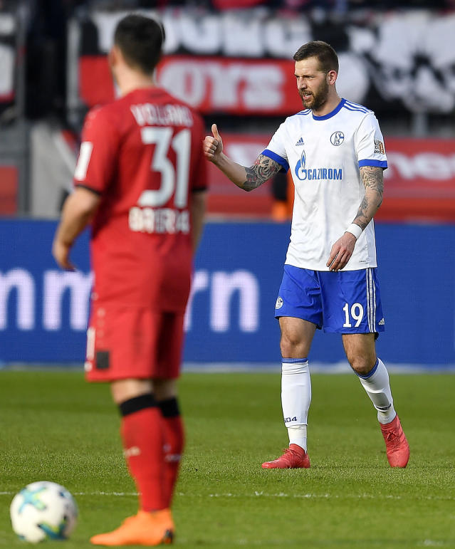 Schalke's Guido Burgstaller, right, shows thumb up after scoring the opening goal against Leverkusen goalkeeper Bernd Leno during the German Bundesliga soccer match between Bayer Leverkusen and FC Schalke 04 in Leverkusen, Germany, Sunday, Feb 25, 2018. (AP Photo/Martin Meissner)