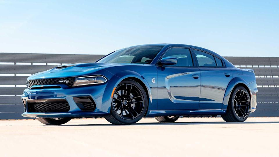 """<p><strong>Score: 6.9 / 10</strong></p> <p>The wide and wildly powerful <a href=""""https://www.motor1.com/reviews/419837/2020-dodge-charger-hellcat-widebody-sedan-review/"""" rel=""""nofollow noopener"""" target=""""_blank"""" data-ylk=""""slk:Dodge Charger Hellcat Widebody"""" class=""""link rapid-noclick-resp"""">Dodge Charger Hellcat Widebody</a> gets a 6.9 out of 10 stars thanks mostly to its 707-horsepower engine and new sheet metal for 2020. The big sedan is extremely comfortable, too, and sports the latest Uconnect infotainment systems. Unfortunately though, that supercharged V8 is thirsty, and the lack of safety equipment throughout the Charger range – particularly here – is damning.</p> <br><a href=""""https://www.motor1.com/reviews/419837/2020-dodge-charger-hellcat-widebody-sedan-review/"""" rel=""""nofollow noopener"""" target=""""_blank"""" data-ylk=""""slk:2020 Dodge Charger Hellcat Widebody Review: More Hip, More Grip"""" class=""""link rapid-noclick-resp"""">2020 Dodge Charger Hellcat Widebody Review: More Hip, More Grip</a><br>"""