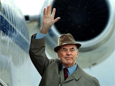 File photo of former German Nazi SS officer Erich Priebke waving to the members of the media as he boards a plane to be extradited to Italy to face a war crimes trial, in Bariloche, southern Argentina