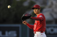 CORRECTS POSITION TO STARTING PITCHER INSTEAD OF DESIGNATED HITTER - Los Angeles Angels starting pitcher Shohei Ohtani takes the ball back from the catcher during the first inning of a baseball game against the Tampa Bay Rays, Wednesday, May 5, 2021, in Anaheim, Calif. (AP Photo/Mark J. Terrill)