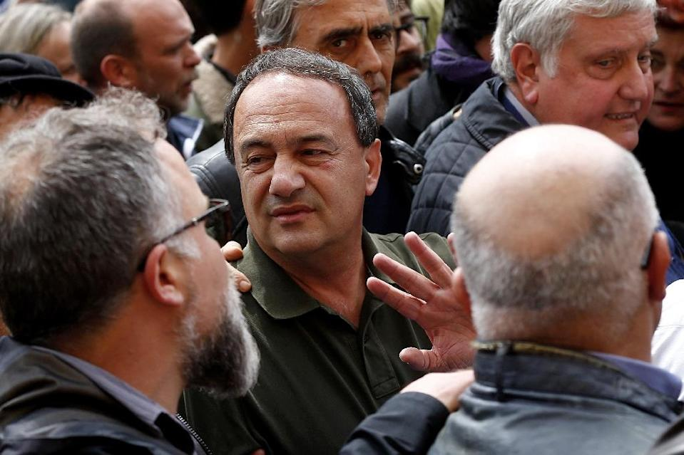 Leftist former mayor Domenico Lucano faces court over a garbage contract that went to a migrant-linked cooperative. He is now barred from Riace (AFP Photo/Filippo MONTEFORTE)