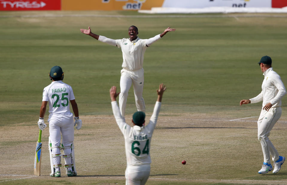 South Africa's Lungi Ngidi, top center, and his teammates appeal an unsuccessful LBW out of Pakistan's batsman Mohammad Rizwan during the second day of the first cricket test match between Pakistan and South Africa at the National Stadium, in Karachi, Pakistan, Wednesday, Jan. 27, 2021. (AP Photo/Anjum Naveed)
