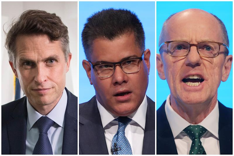 Gavin Williamson, left, defended the government's school face mask U-turn on Wednesday after fellow ministers Alok Sharma, centre, and Nick Gibb, right, had previously said masks would not be necessary.