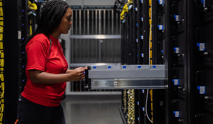 A Dropbox employee installs new storage technology in one of the company's data centers.